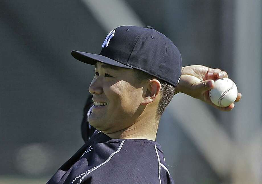 New York Yankees starter Masahiro Tanaka loosens up his arm before throwing a bullpen session Thursday at the team's minor league complex in Tampa, Fla. Photo: Chris O'Meara — The Associated Press  / AP