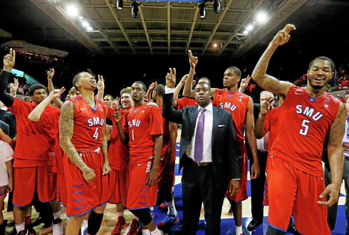 SMU celebrates its 74-65 win over No. 17 UConn on Saturday in Dallas.