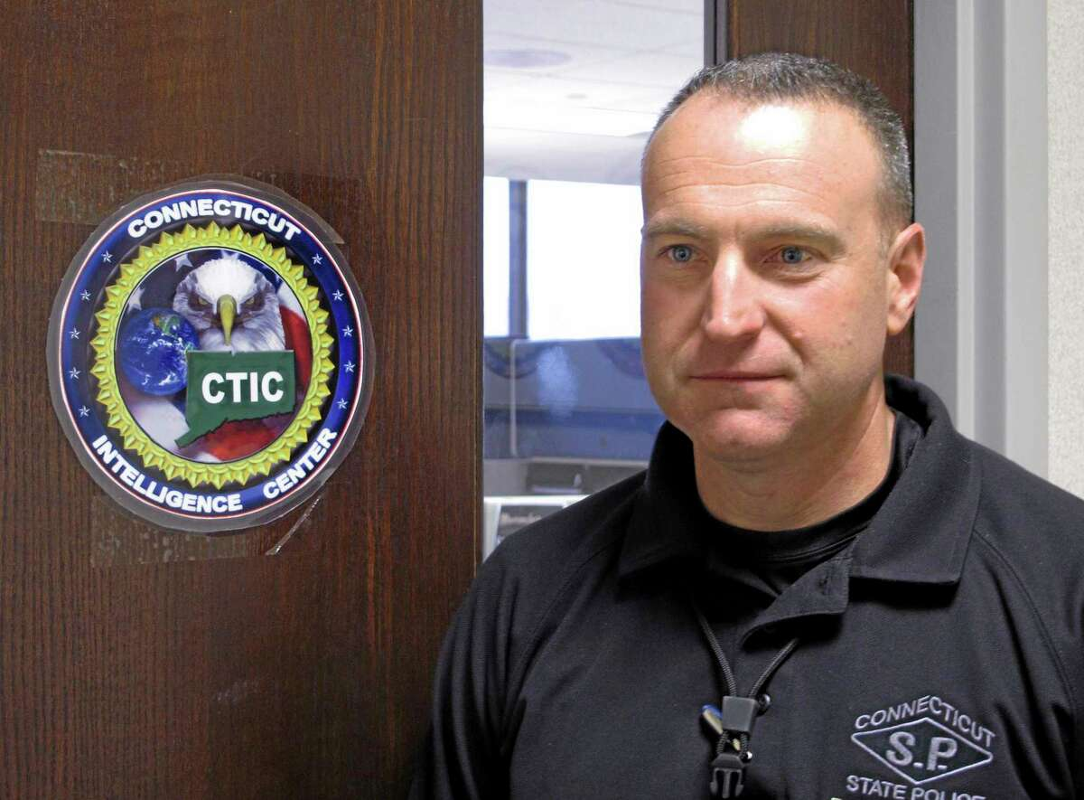 """In this Tuesday, Dec. 3, 2013 photo, Maj. Louis J. Fusaro Jr. of the Connecticut State Police stands outside the Connecticut Intelligence Center in Hartford, Conn. The Intelligence Center is part of a national network of 78 """"fusion centers"""" developed by state and federal officials to improve law enforcement information sharing after the Sept. 11, 2001, terrorist attacks. Fusaro is director of the Connecticut center, and commanding officer of emergency services and counter-terrorism for state police. (AP Photo/Dave Collins)"""