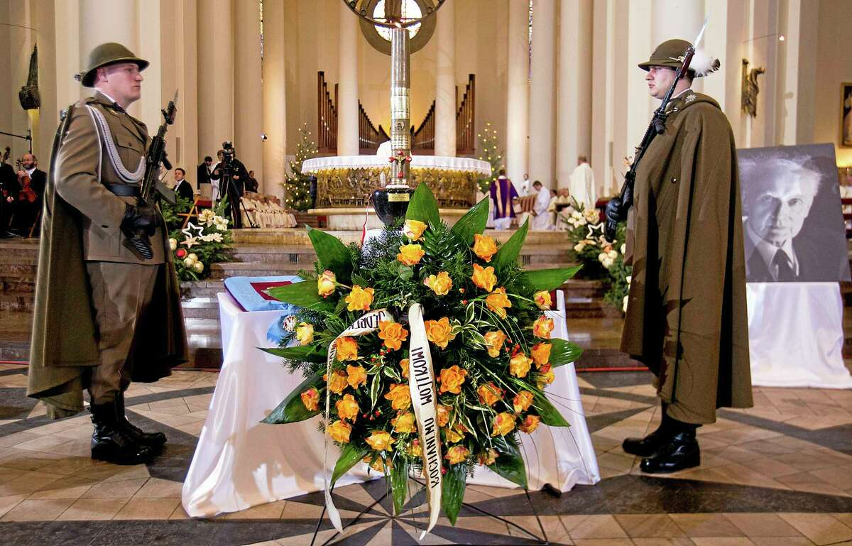 """The dark stone urn with the ashes of Polandís pianist and composer Wojciech Kilar placed in front of the altar during the composerís state funeral at the Cathedral of Christ the King in Katowice, Poland, on Saturday, Jan. 4, 2014. Mourners, including Culture Minister Bogdan Zdrojewski, hailed Kilar, a symphonic composer, as a glorious figure in Polish and European music. He gained fame writing film scores for Oscar-winning """"The Pianist"""" and """"Bram Stoker's Dracula."""" Kilar, 81, died of cancer on Sunday Dec. 29, 2013, in his hometown of Katowice. (AP Photo/ Tomasz Dudzinski) POLAND OUT"""