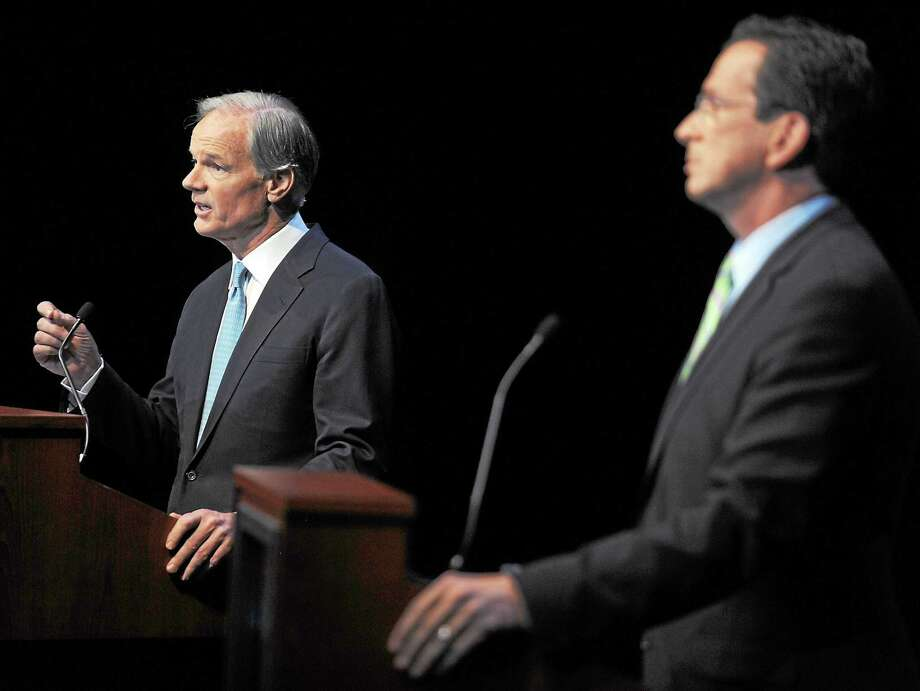 Republican Tom Foley, left, faces Democrat Dan Malloy in a gubernatorial debate held at the Garde Arts Center in New London, Conn., Wednesday, Oct. 13, 2010. (AP Photo/Tim Martin, Pool) Photo: AP / 2010 The Day Publishing Company