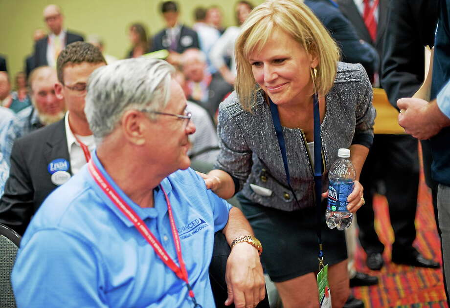 Lisa Wilson-Foley, right, talks with delegate George Castle of Plymouth at the Republican state convention in Hartford, Conn. on May 18, 2012. Photo: AP Photo/Jessica Hill  / AP2012