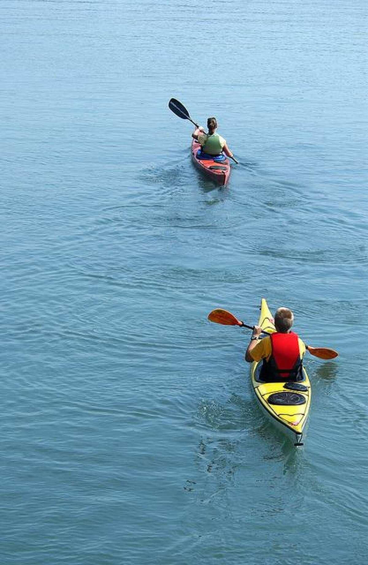 File photos Kayakers enjoy the water.