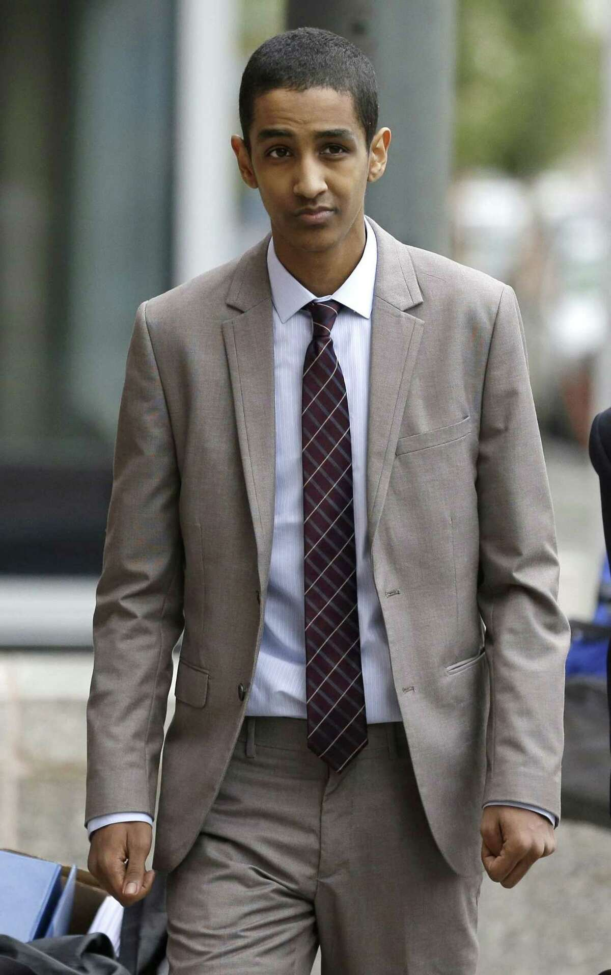 FILE - In this Oct. 16, 2014 file photo, Robel Phillipos, a college friend of Boston Marathon bombing suspect Dzhokhar Tsarnaev, arrives at federal court to attend his trial in Boston. Closing arguments are being held in the case Tuesday, Oct. 21, 2014. Phillipos is charged with lying to the FBI about being in Tsarnaev's dorm room while two other friends removed a backpack containing fireworks and other potential evidence several days after the April 15, 2013 attack. (AP Photo/Steven Senne, File)