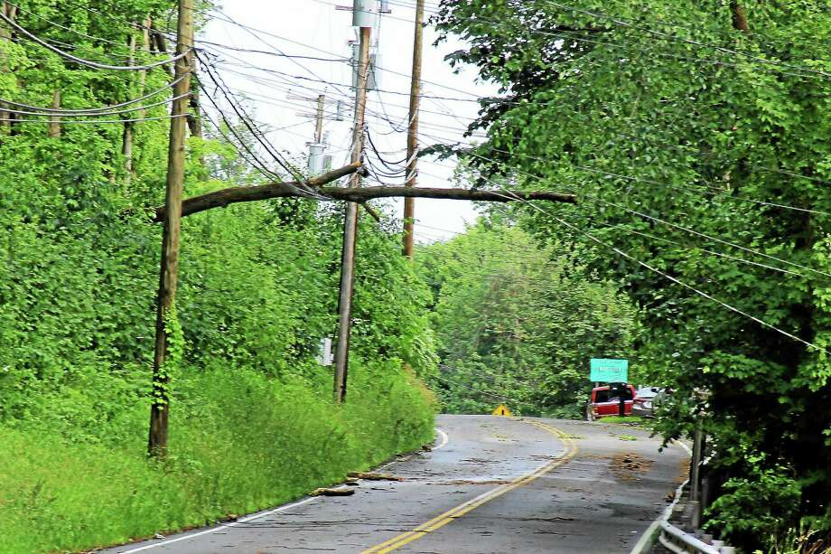 (Kathleen Schassler/Middletown Press)Route 147 in Middlefield was closed on Tuesday when a downed tree hit some power lines. Trees reportedly also hit cars on Route 157 with live wires involved and another car vs. tree on Maple Street. The storm moved through at about 5 o'clock, creating havoc in 10-15 minutes. Photo: Journal Register Co. / Kathleen Schassler All Rights