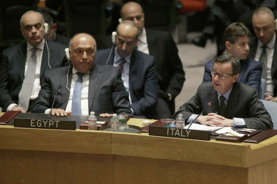Egyptian Ambassador Amr Abdellatif Aboulatta, left, listens as Italian Ambassador Sebastiano Cardi speaks during a Security Council meeting on the situation in Libya, Wednesday, Feb. 18, 2015, at United Nations headquarters.  (AP Photo/Mary Altaffer) Photo: AP / AP