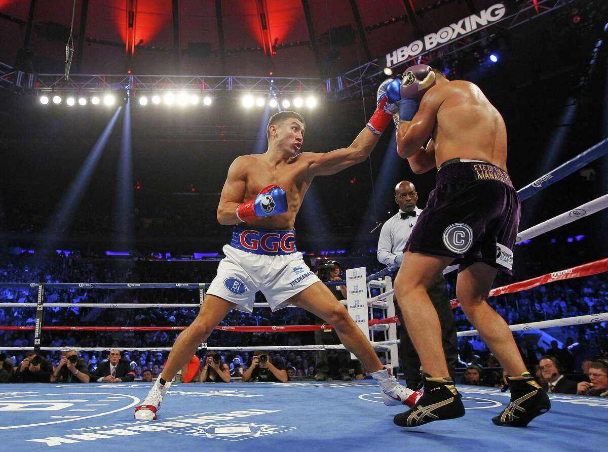 Gennady Golovkin, left, beat David Lemieux by TKO Saturday night in a world middleweight championship title unification bout at Madison Square Garden in New York.