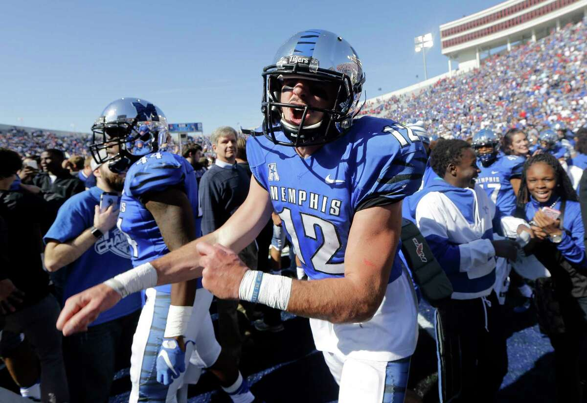 Memphis quarterback Paxton Lynch (12) yells as he celebrates after Memphis upset No. 13 Mississippi 37-24 on Saturday.