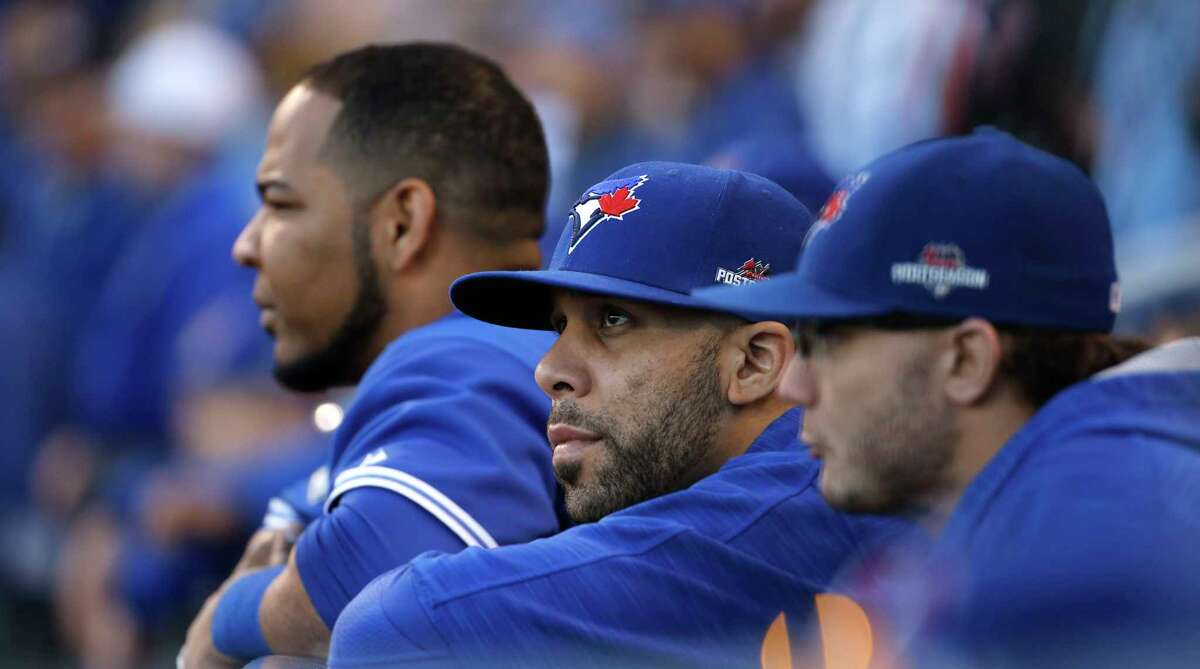 Blue Jays starting pitcher David Price, center, watches the eighth inning of Game 2 of the ALCS on Saturday.