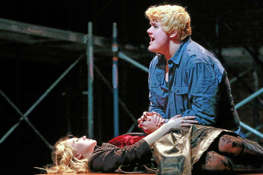 "Musician Roger Davis, played by Mark Sumner, grieves over the near death of his girlfriend Mimi Marquez, played by Maya Eriksen, in Middletown High's 2013 drama club production of ""Rent."" Photo: File Photo"