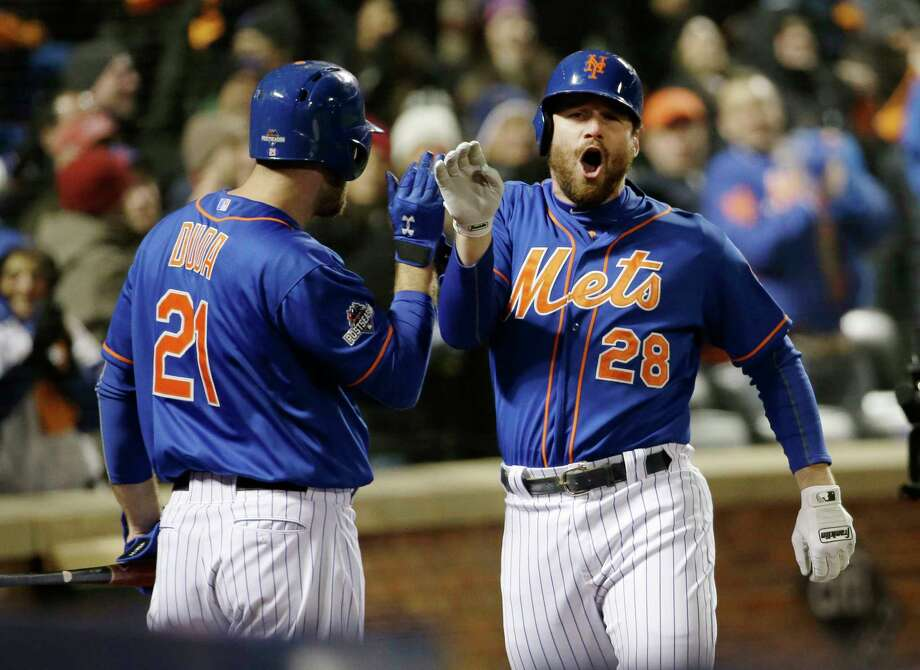 The Mets' Daniel Murphy is congratulated by teammate Lucas Duda after hitting a two-run home run in the first inning Sunday. Photo: David J. Phillip — The Associated Press  / AP
