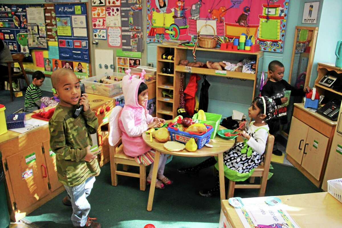 Children enjoy playful learning time at Middletown Head Start program for preschoolers age 33 months to 4 years.