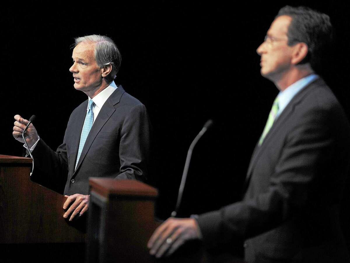 Republican Tom Foley, left, faces Democrat Dan Malloy in a gubernatorial debate held at the Garde Arts Center in New London, Conn., Wednesday, Oct. 13, 2010. (AP Photo/Tim Martin, Pool)