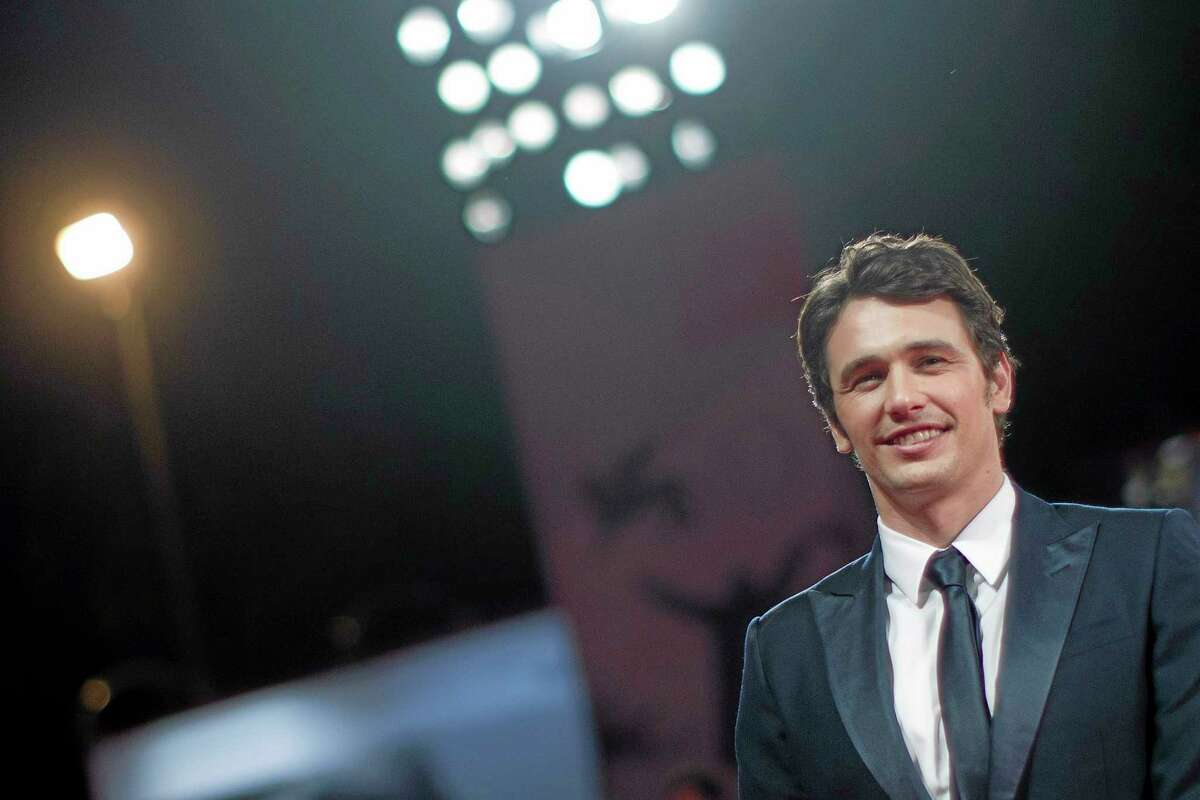 """FILE - In this Aug. 31, 2013 file photo, actor and director James Franco poses for photographers on the red carpet for the screening of the film """"Child Of God"""" at the 70th edition of the Venice Film Festival in Venice, Italy. (AP Photo/Andrew Medichini, File)"""
