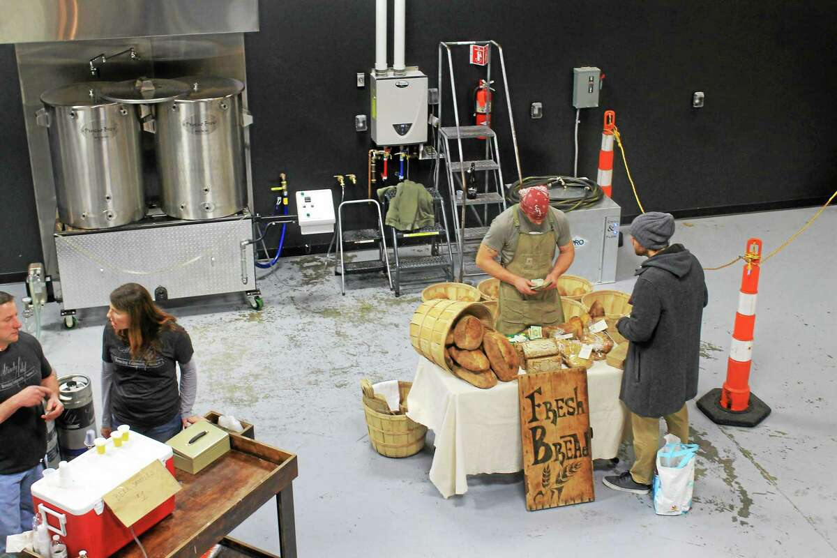 Valerie Bannister — Special to the Press Beer and bread are sold on Saturdays, during limited hours, at the new Steady Habit Brewing Company in Haddam. The bread, made by Farm to Hearth, is wood-fired and some includes grain from the beer making.