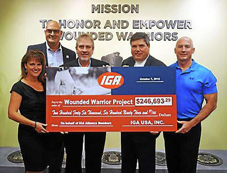 CONTRIBUTED PHOTOIGA this month donated $245,000 to the Wounded Warrior Project as part of the fifth-annual IGA Exclusive Brand donation initiative. Photo: Journal Register Co.