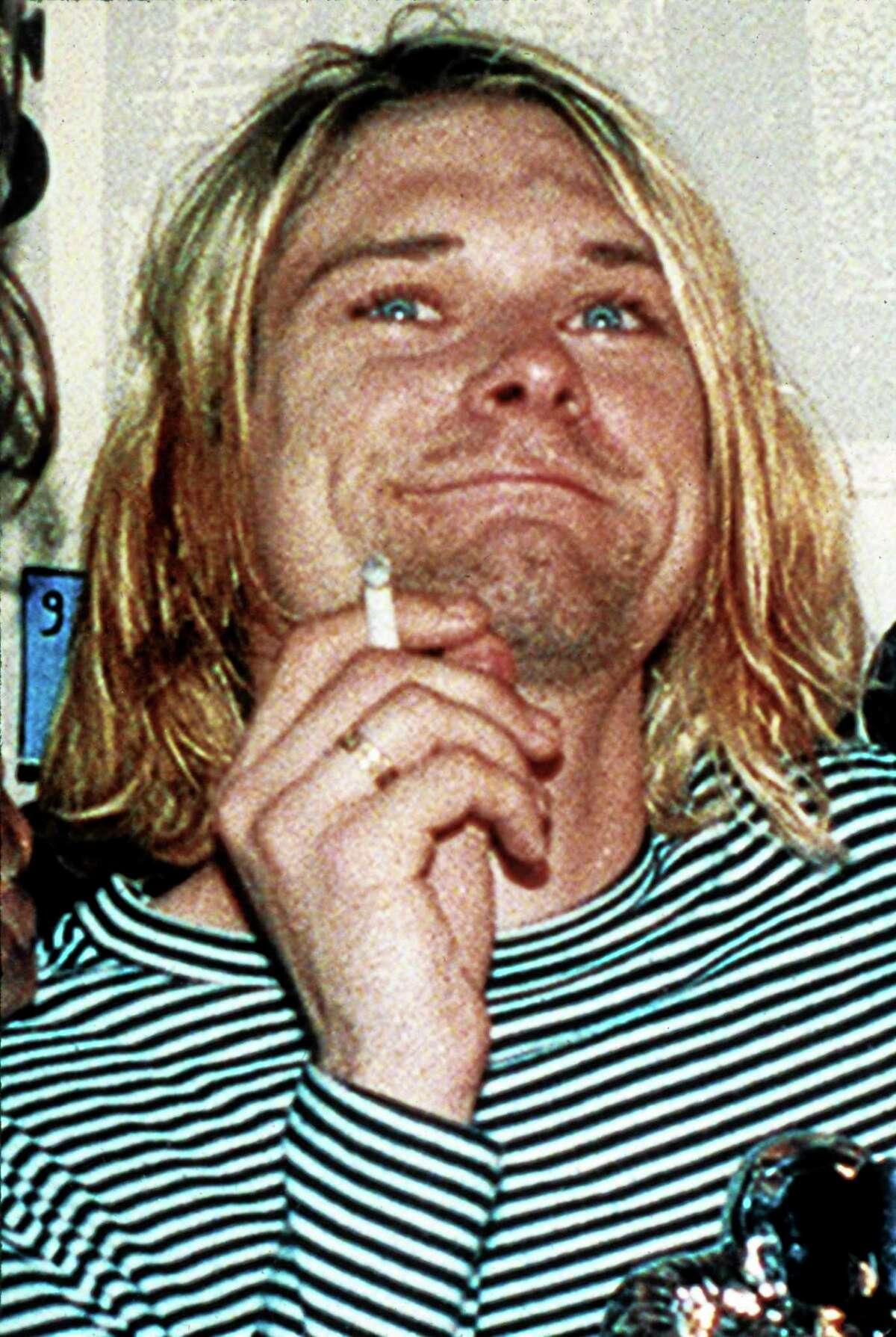 FILE - This 1993 file photo shows Kurt Cobain, lead singer of Nirvana.