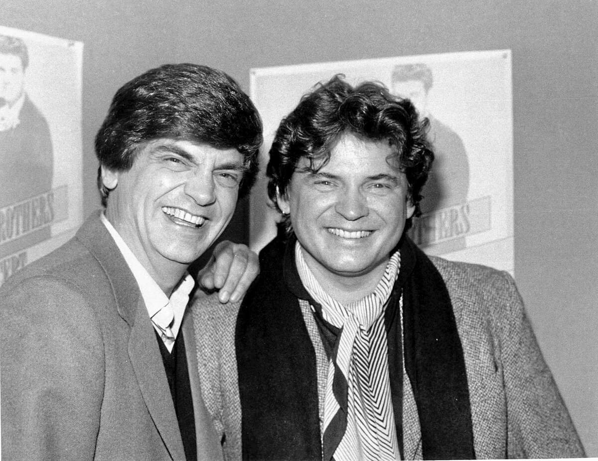 FILE - In this Jan. 4, 1984 file photo, Phil, left, and Don Everly, of the Everly Brothers joke around for photographers in New York City. Everly, who with his brother Don formed an influential harmony duo that touched the hearts and sparked the imaginations of rock 'n' roll singers for decades, including the Beatles and Bob Dylan, died Friday, Jan. 3, 2014. He was 74. Everly died of chronic obstructive pulmonary disease at a Burbank hospital, said his son Jason Everly. (AP Photo/Ray Stubblebine, File)