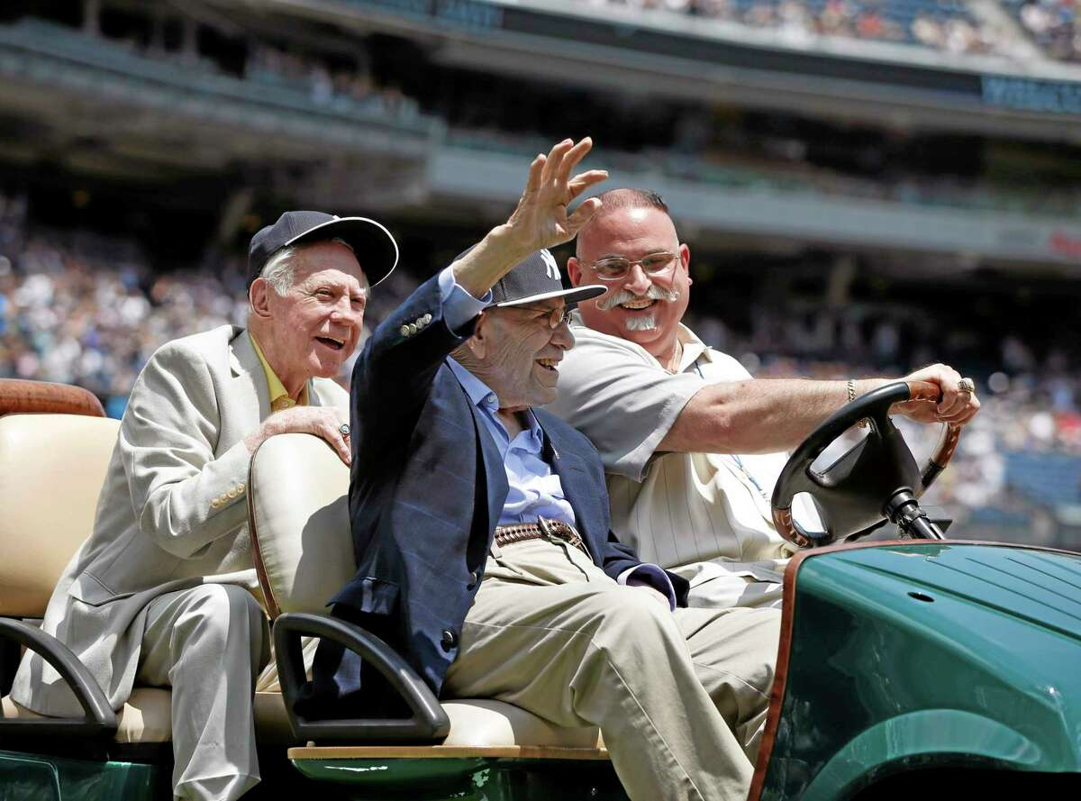 Hall of Fame pitcher Whitey Ford, left, laughs as he and former teammate and Hall of Famer catcher Yogi Berra are introduced during the 68th annual Old Timers' Day prior to the Baltimore Orioles vs. Yankees game on Sunday at Yankee Stadium in New York.