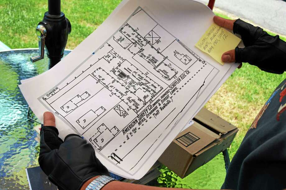 Chris Hinze of Middletown hold blueprints at the site where the first Indian Motorcycle was made. Photo: File