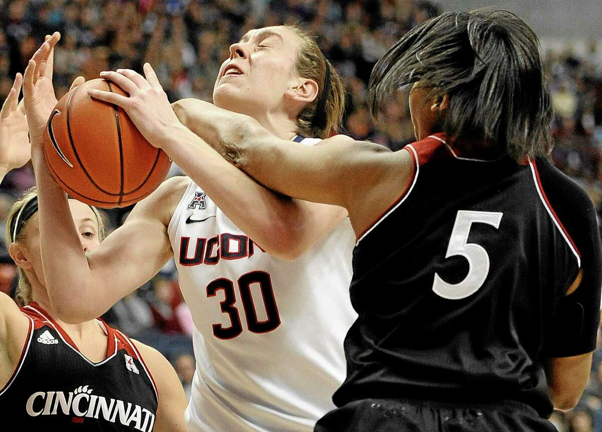 UConn's Breanna Stewart, here getting fouled by Cincinnati's Alexis Durley, has struggled during her last two games, but the undefeated, top-ranked Huskies have kept rolling along.