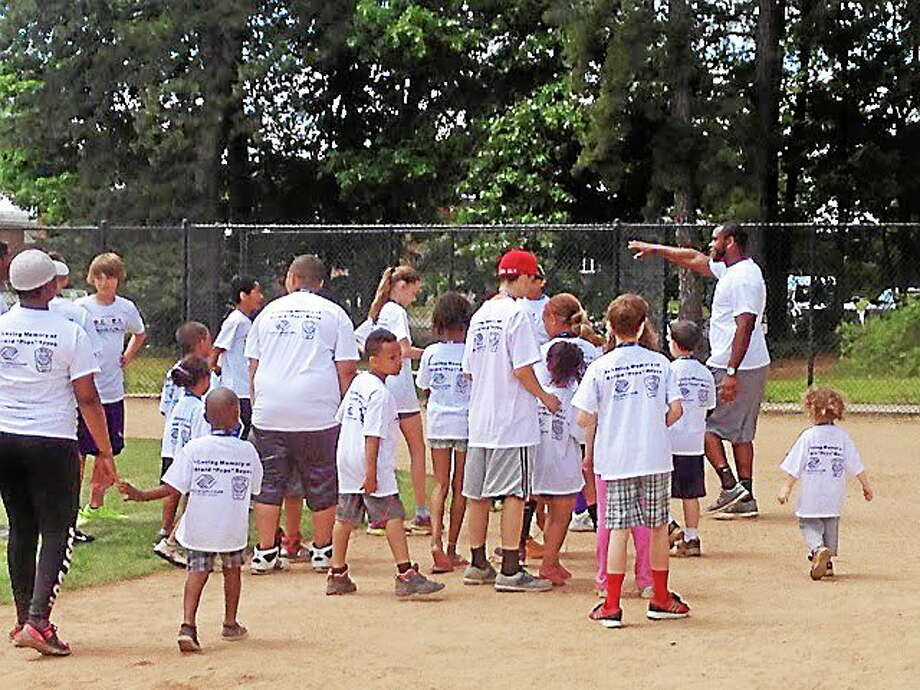 Former UConn star and current San Diego Chargers defensive end Kendall Reyes returned to his hometown of Nashua, N.H., to host his second R.E.Y.E.S Family Field Day. Photo: Jim Fuller — Register