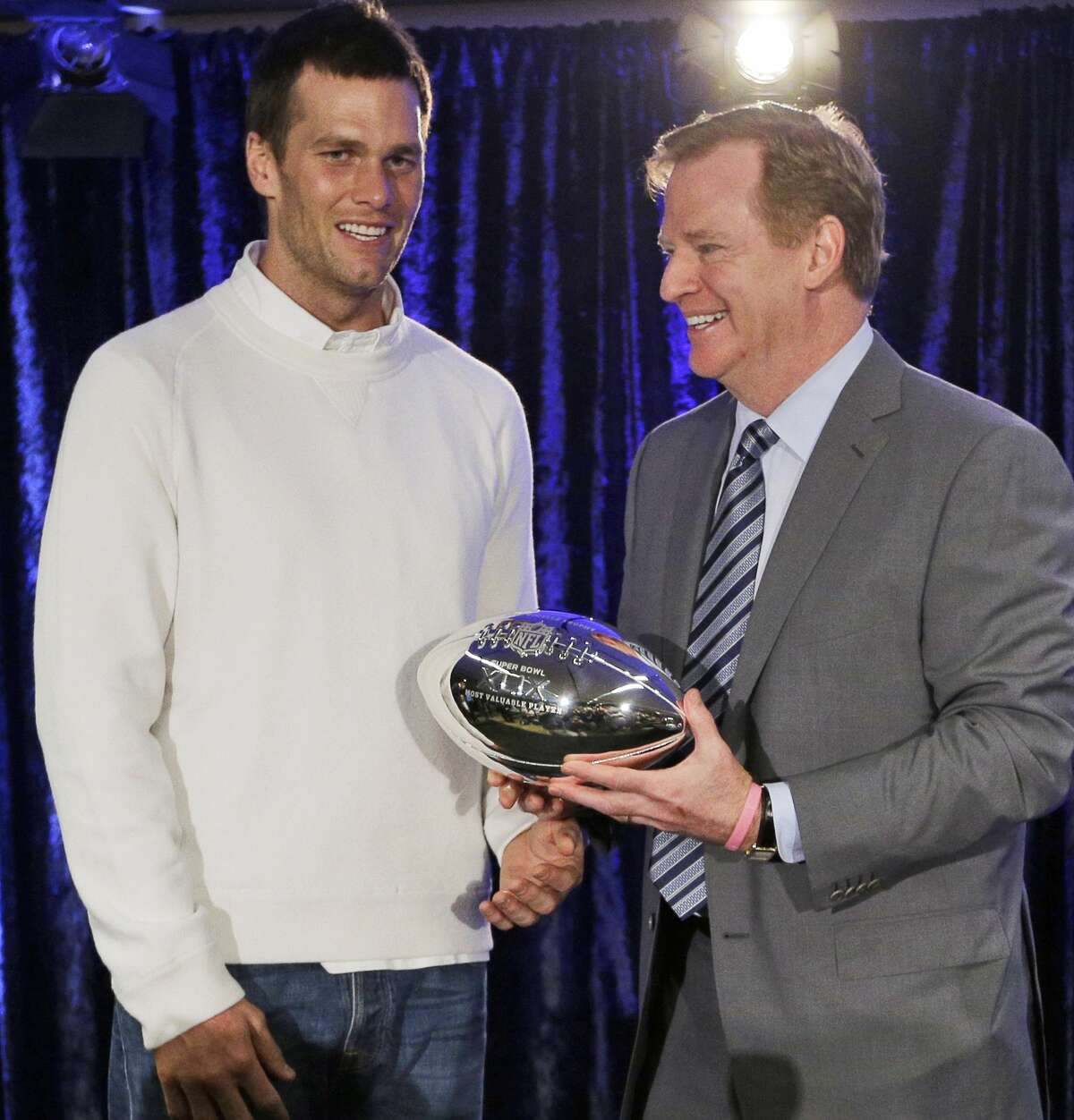 In this Feb. 2 file photo, New England Patriots quarterback Tom Brady poses with NFL Commissioner Rodger Goodell during a news conference after Super Bowl XLIX in Phoenix, Ariz.