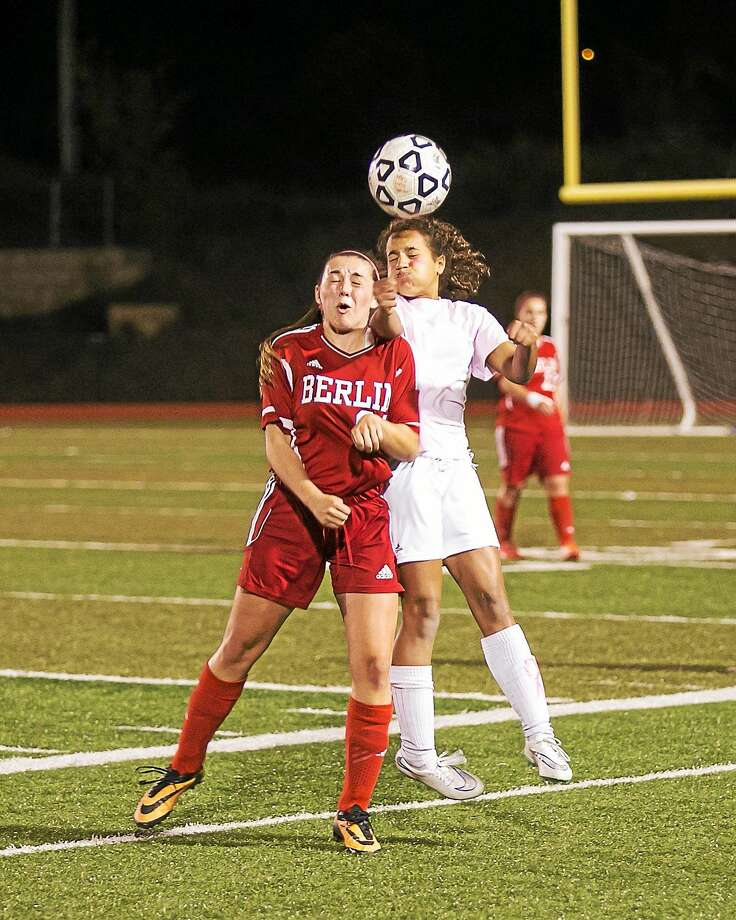 Middletown's Sam Fletcher battles for the ball against Berlin Monday night. Photo: Sandy Aldieri — Special To The Press