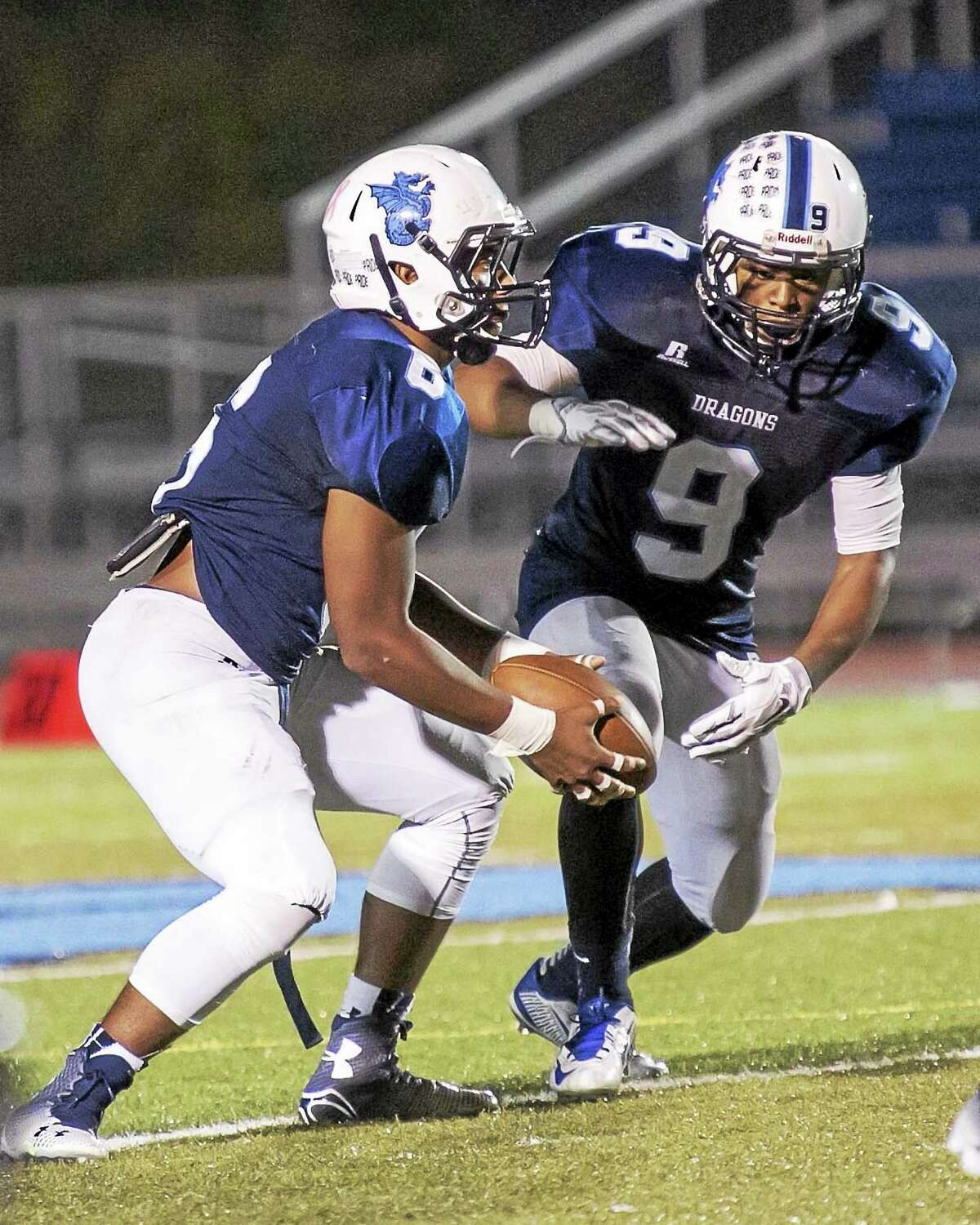 Middletown's Dario Highsmith hands off to teammate Calvin Mackey, Jr. to advance the Dragons for a win against Fermi.