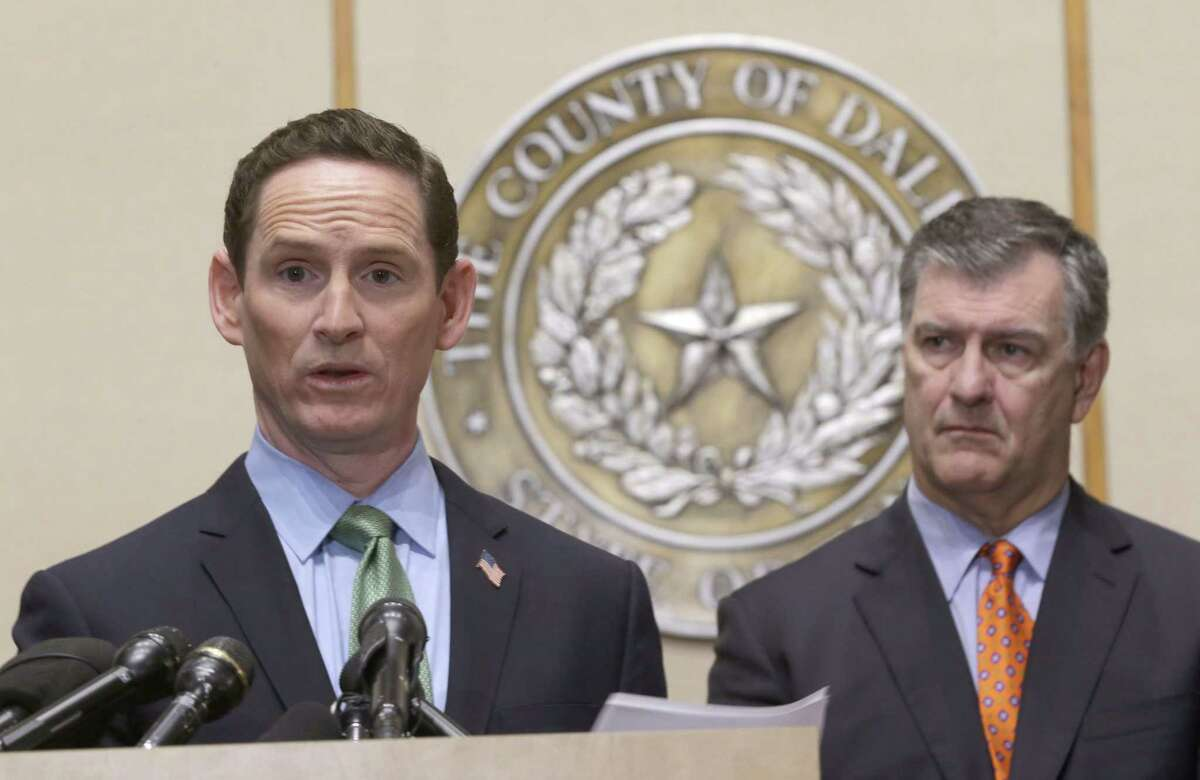 Dallas County Judge Clay Jenkins, left, speaks as Dallas Mayor Mike Rawlings, right, looks on during a news conference Monday, Oct. 20, 2014, in Dallas.