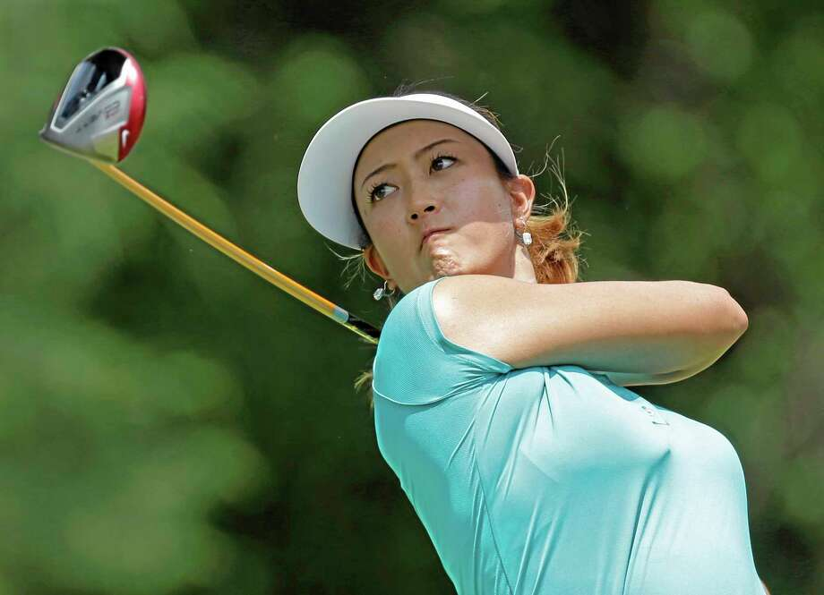 Michelle Wie watches her tee shot on the seventh hole during the final round of the U.S. Women's Open on Sunday in Pinehurst, N.C. Photo: Bob Leverone — The Associated Press  / FR170480 AP