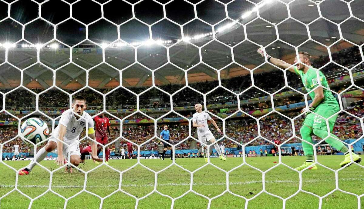 The United States' Clint Dempsey, left, scores his side's second goal during the group G World Cup match against Portugal on Sunday at the Arena da Amazonia in Manaus, Brazil.