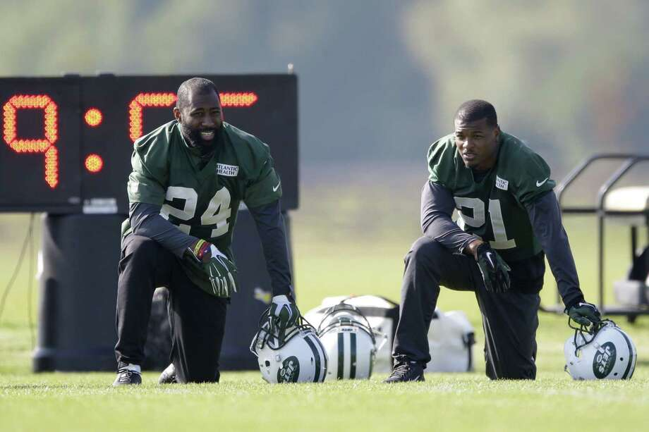 New York Jets cornerback Darrelle Revis, left, and free safety Marcus Gilchrist will look to shut down the Washington offense. Photo: The Associated Press File Photo  / AP