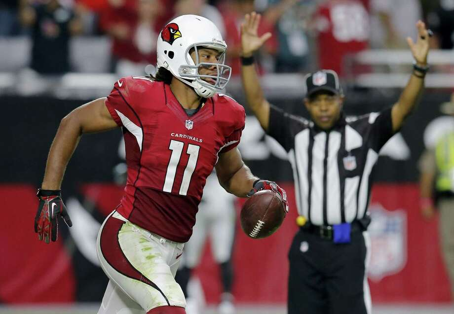 Larry Fitzgerald has agreed to a two-year deal that will keep him with Arizona. General manager Steve Keim made the announcement Wednesday. Photo: Rick Scuteri — The Associated Press File Photo  / FR157181 AP