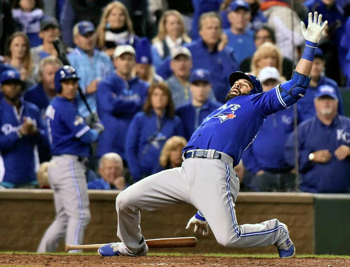 The Toronto Blue Jays' Jose Bautista leans back on a close pitch from Kansas City Royals reliever Ryan Madson during the eighth inning of Game 1 of the ALCS on Friday night.