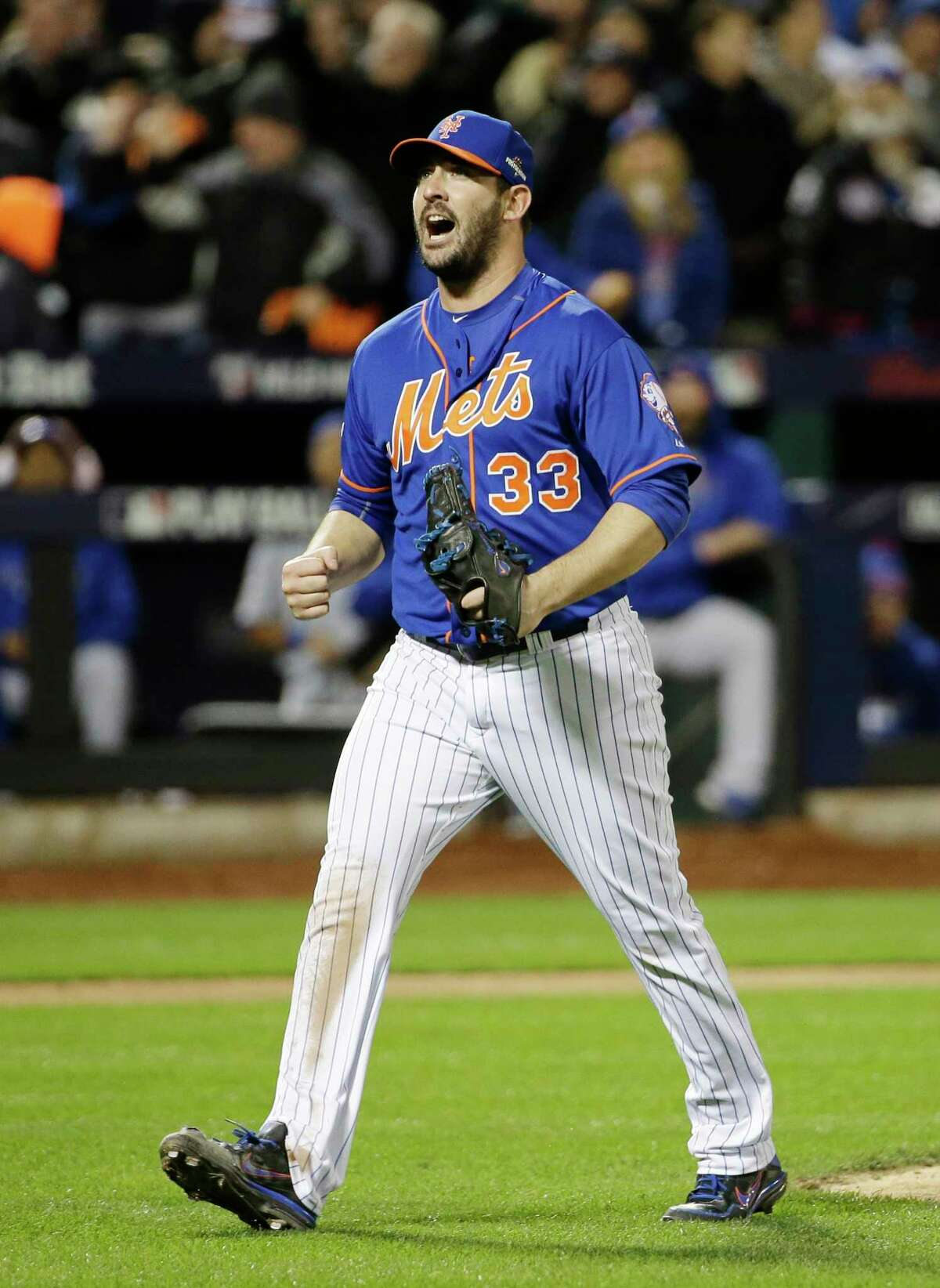 Mets pitcher Matt Harvey reacts after getting the Cubs' Tommy La Stella to strike out in the seventh inning.