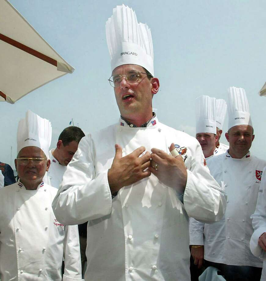 In this July 27, 2004 photo, outgoing White House chef Walter Scheib greets chefs from around the world at the Chesapeake Bay Maritime Museum in St. Michaels, Md. Searchers found Scheib's body Sunday night, June 21, 2015, near a hiking trail in mountains in the Taos, N.M. area, the New Mexico State Police said. Photo: AP / AP