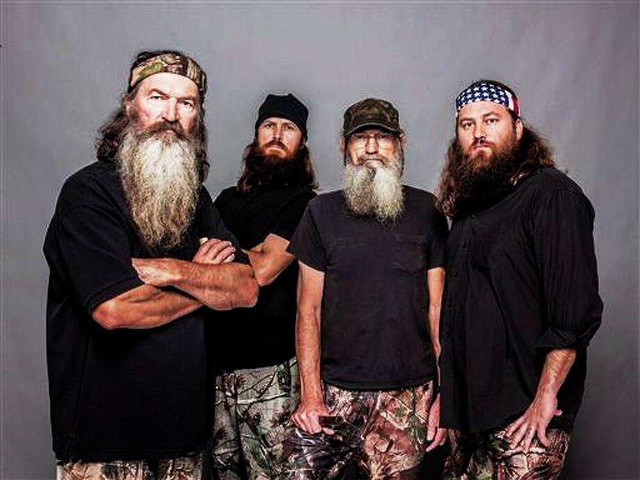 "This 2012 photo released by A&E shows, from left, Phil Robertson, Jase Robertson, Si Robertson and Willie Robertson from the A&E series, ""Duck Dynasty."" (AP Photo/A&E, Zach Dilgard) Photo: ASSOCIATED PRESS / A20122012"