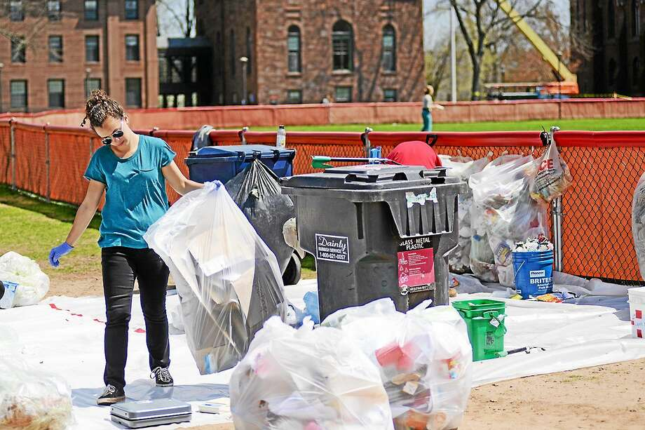 Sustainability staff and interns sorted trash and recycling from residence halls in order to investigate how to effectively reduce campus waste at a 2013 Residential Waste Audit at Wesleyan University in Middletown. Photo: Courtesy Wesleyan University
