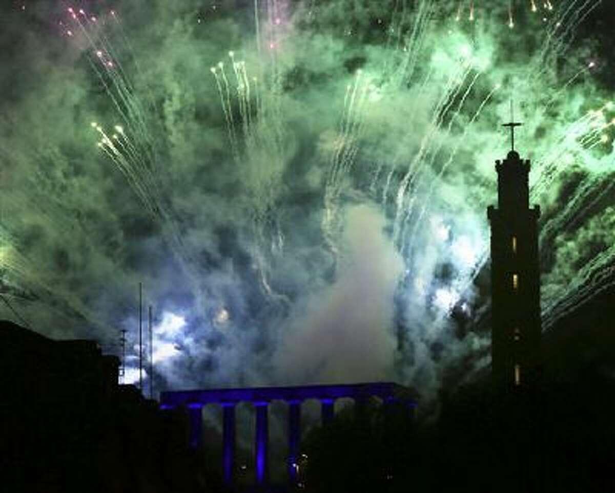 Fireworks illuminate the sky over Calton Hill, Edinburgh, Scotland, on New Year's Eve.
