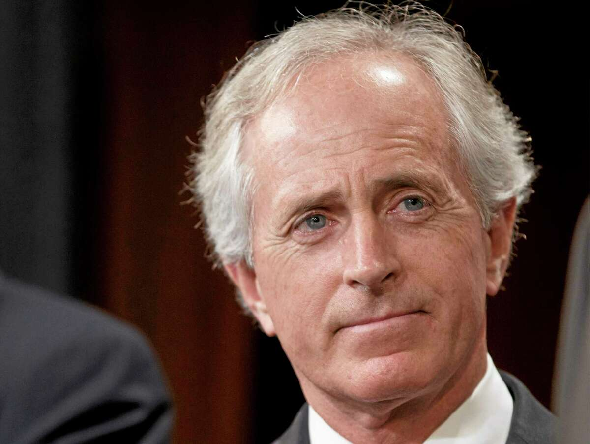 This April 30, 2014 file photo shows Sen. Bob Corker, R-Tenn. on Capitol Hill in Washington. Two senators proposed Wednesday to raise federal gasoline and diesel taxes for the first time in more than two decades as Congress struggles with how to pay for highway and transit programs. Sen. Chris Murphy, a Connecticut Democrat, and Corker, a Tennessee Republican, pitched their plan as a bipartisan solution to replenish the federal Highway Trust Fund. That fund is forecast to go broke in late August. (AP Photo, File)