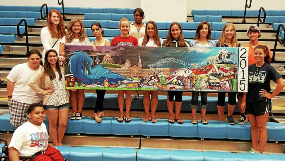 From left are Middletown High School senior art project students Kylie Guevarez, Robert Varszegi, Wendy Smith, Julia Fitzgerald, Marissa Bowen, Amanda Boewn, Renee Riddick, Adrianna Ciebielski, Natianna Quinones, Dahlia Dehaan, Marissa Birdsall, Maxine Philavong, Christopher McGrath and Adriel Centano. Not shown are Logan Hunter and Yaliyana Olivo. Photo: Courtesy Middletown High School