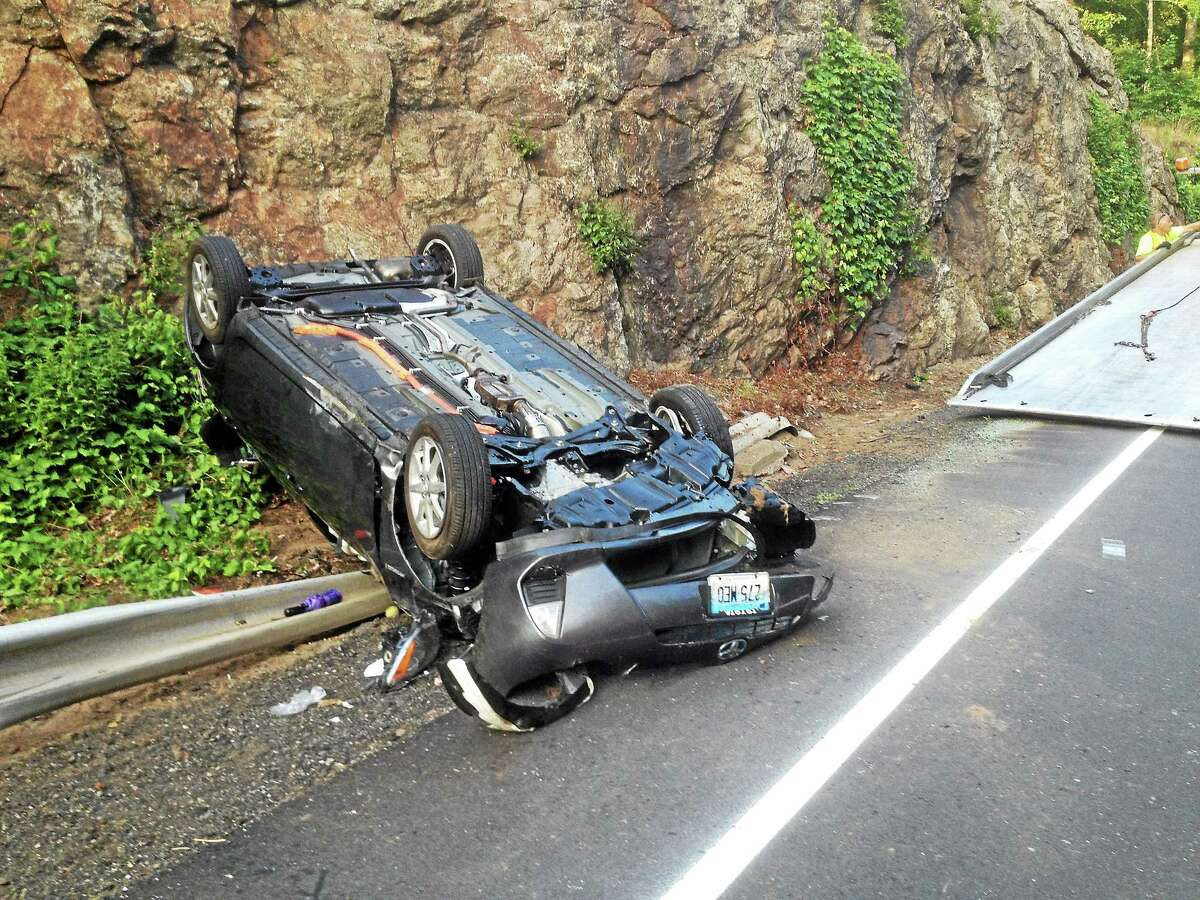 A Prius is seen on its roof following a crash last July on Route 66 in Portland that brought Lifestar to the scene.