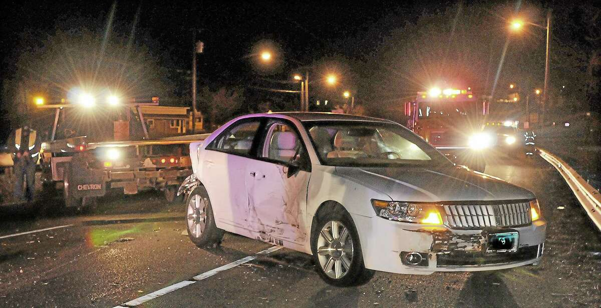 A Lincoln MK Z four-door sedan collided with a pickup truck in the eastbound lane on Route 66 in Portland in 2013. The driver of the truck was arrested at the scene.