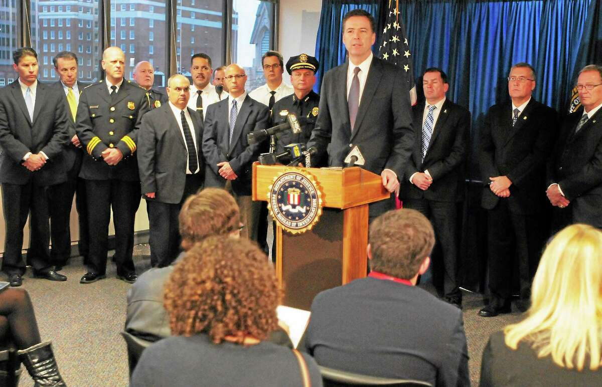 FBI Director James Comey answers questions at a press conference during a December 2013 visit to the New Haven FBI Field Office and with Police Chief in Connecticut and the Connecticut State Police.