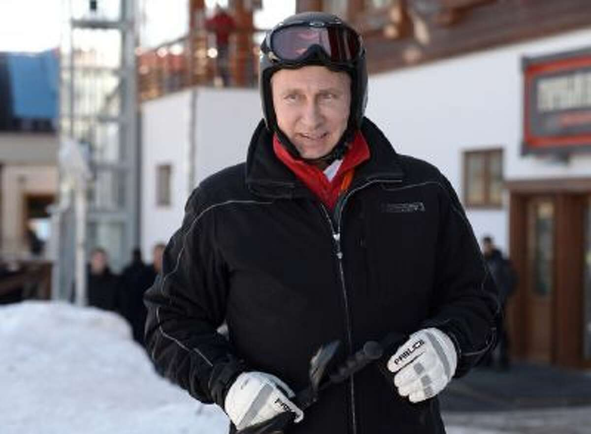 Russian President Vladimir Putin prepares to ski in the mountain resort of Krasnaya Polyana near the Black Sea resort of Sochi, southern Russia, Friday, Jan. 3, 2014.