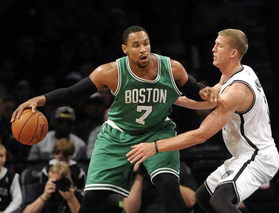 Celtics center Jared Sullinger (7) looks to pass the ball around Nets forward Mason Plumlee during the first half Sunday. Photo: Kathy Kmonicek — The Associated Press  / FR170189 AP
