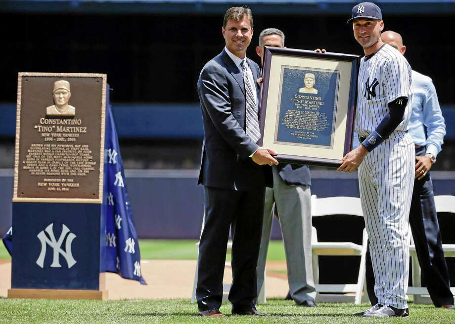 Former Yankees first baseman Tino Martinez, left, poses with shortstop Derek Jeter and a replica of a plaque dedicated to his time with the Yankees before of Saturday's game against the Baltimore Orioles in New York. The plaque, left, will hang at the stadium's Monument Park. Photo: Julie Jacobson — The Associated Press  / AP