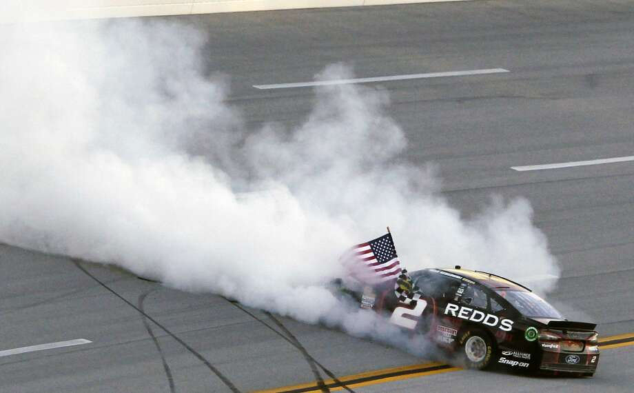 Brad Keselowski celebrates after winning at Talladega Superspeedway on Sunday. Photo: Butch Dill — The Associated Press  / FR111446 AP