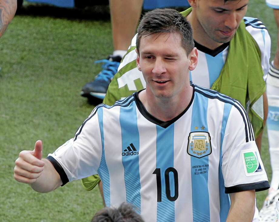Argentina's Lionel Messi winks as he leaves the pitch after the group F World Cup match against Iran on Saturday at the Mineirao Stadium in Belo Horizonte, Brazil. Messi scored a superb goal in stoppage time to give Argentina a 1-0 victory. Photo: Sergei Grits — The Associated Press  / AP